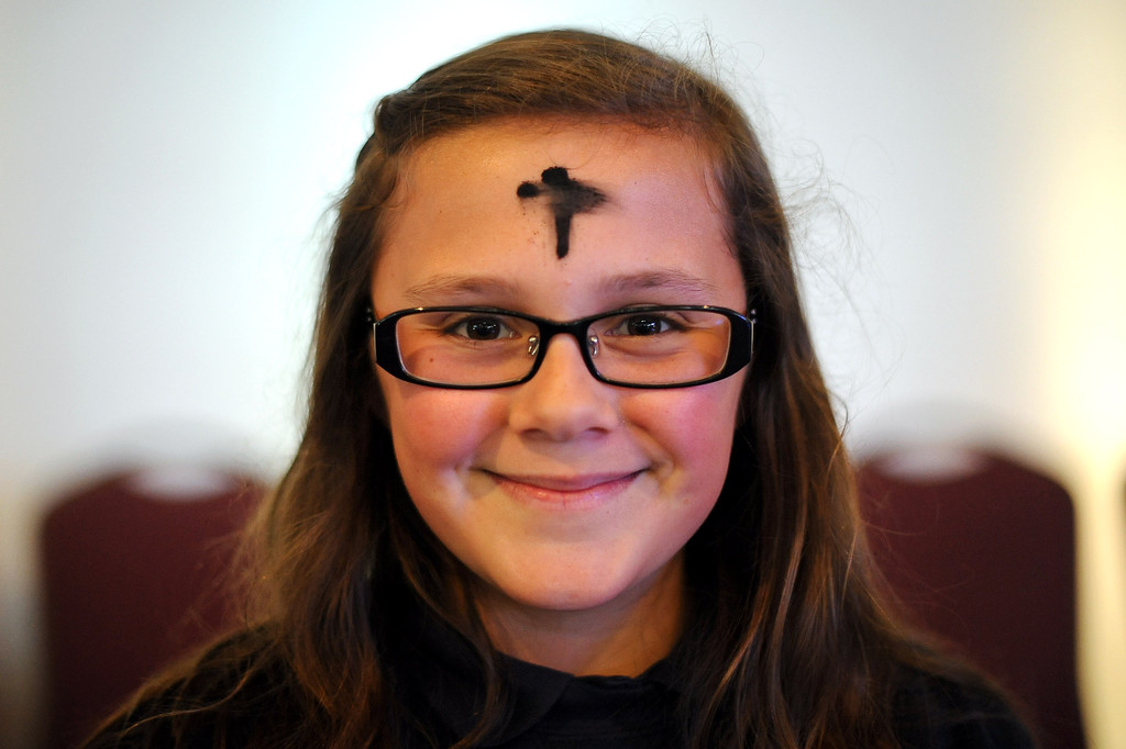. Breeanna Hawking participated in the Ash Wednesday Mass at the Saint Euphrasia Catholic Church in Granada Hills, CA March 5, 2014.(Andy Holzman/Los Angeles Daily News)