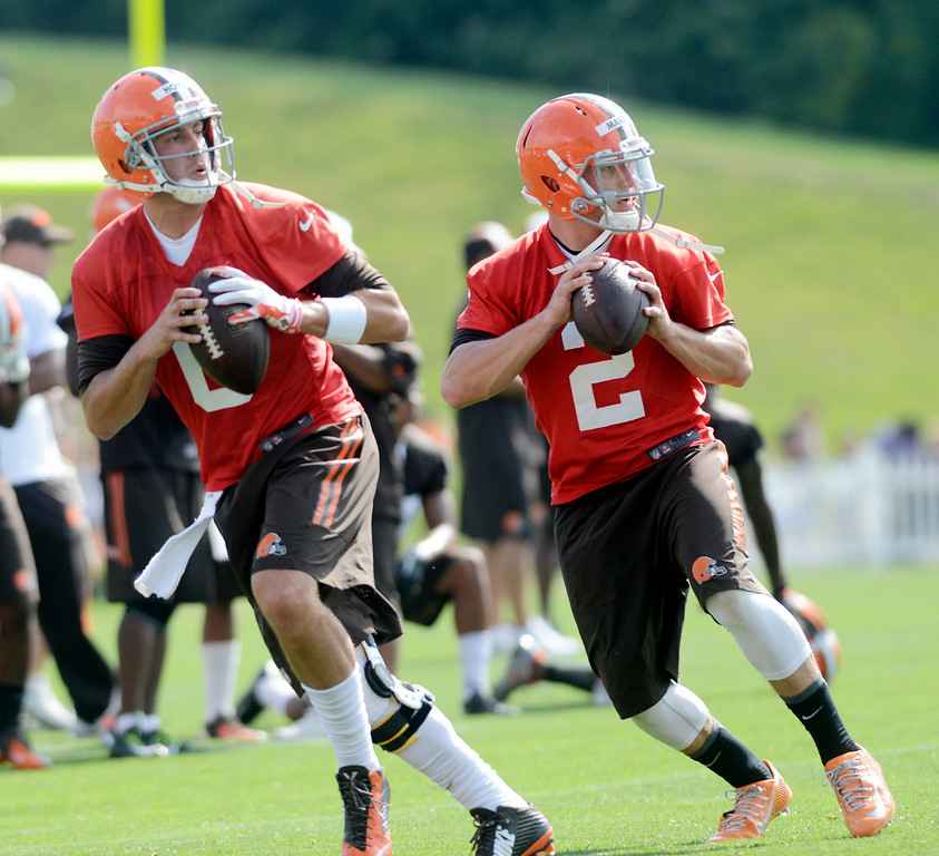 . Duncan Scott/DScott@News-Herald.com Quarterbacks Brian Hoyer, left, and Johnny Manziel run passing drills as the Cleveland Browns opened training camp on July 26 with their first practice at Browns headquarters in Berea.
