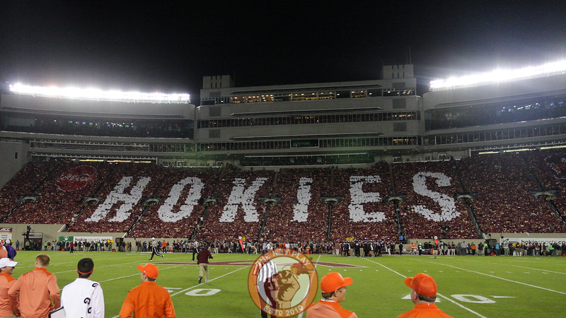 Fans in Lane Stadium take part in a card stunt between the first and second quarters of the game. (Mark Umansky/TheKeyPlay.com)
