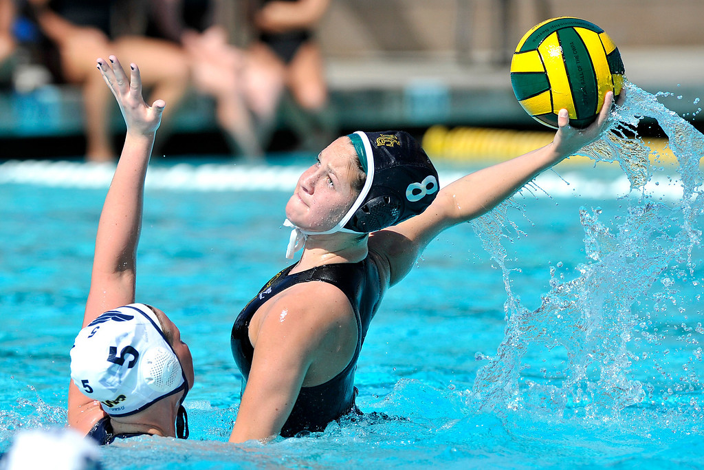 . MANHATTAN BEACH - 2/16/2013 - (Mark Savage) GIRLS WATER POLO: Arroyo Grande at Mira Costa. CIF Southern Section Division III quarterfinal. Mira Costa player #8 Isabella Magno makes a goal attempt  over Arroyo Grande defensive player #5 Brooklyn VanderVeen during the second half.