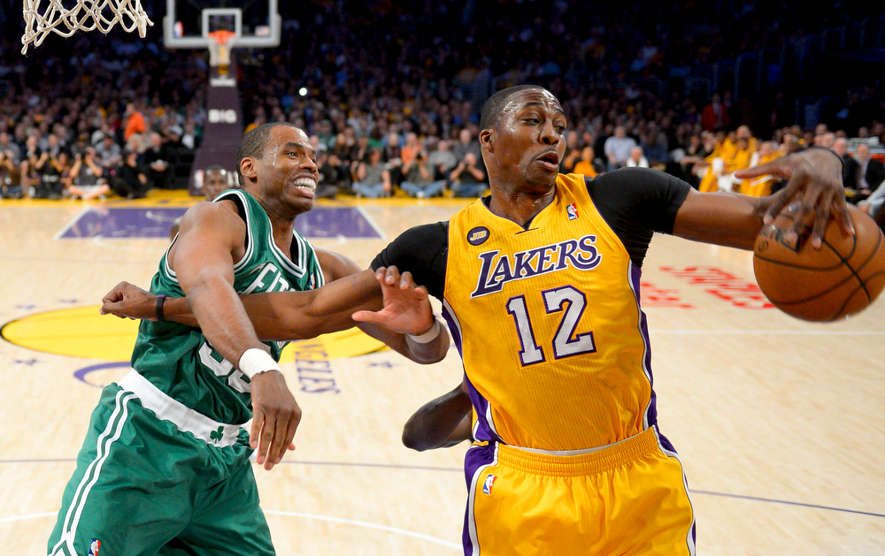 . Boston Celtics center Jason Collins battles Los Angeles Lakers center Dwight Howard (12) for a rebound during the first half of their NBA basketball game, Wednesday, Feb. 20, 2013 in Los Angeles. NBA veteran center Collins has become the first male professional athlete in the major four American sports leagues to come out as gay. Collins wrote a first-person account posted Monday, April 29, 2013 on Sports Illustrated\'s website.(AP Photo/Mark J. Terrill, File)