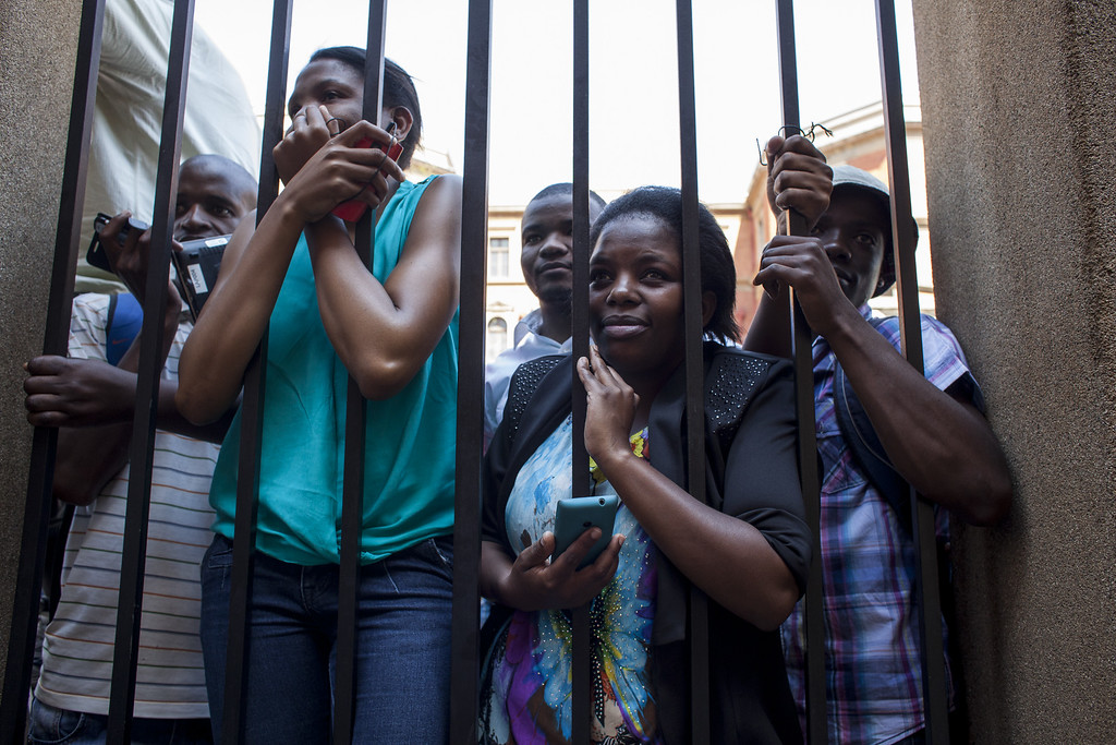 . Members of the public try to get a glimpse of Oscar Pistorius outside North Gauteng High Court on September 11, 2014 in Pretoria, South Africa. (Charlie Shoemaker/Getty Images)
