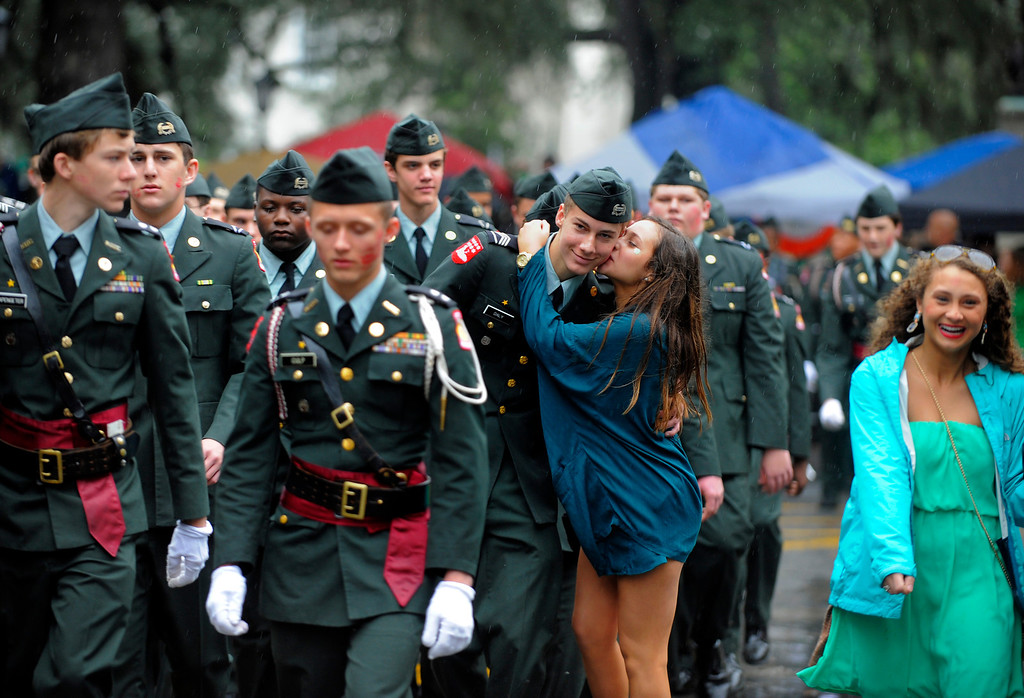 . A cadet from the Benedictine Military School gets kissed by a young lady during Savannah\'s 190-year-old St. Patrickís Day parade, Monday, March 17,  2014, in Savannah, Ga. Kissing men in uniform is a tradition during the celebration in Georgia\'s first city. (AP Photo/Stephen B. Morton)