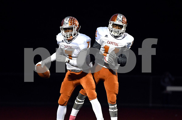 10/27/2017 MIke Orazzi | Staff CapitalPrep/Achievement's John Edwards (7) and Anthony Benefield (11) during Friday night's football game with Bristol Central.