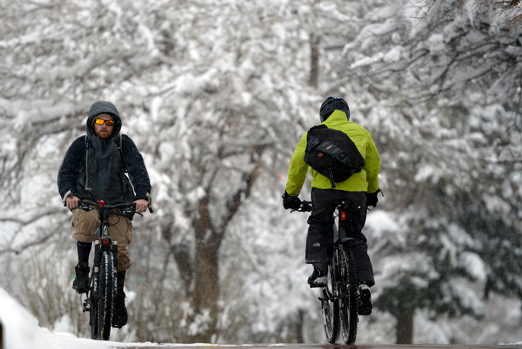 . BOULDER, CO- APRIL 17, 2013: Students on the University of Colorado campus make their way through the falling snow.  Snow continues to fall in Boulder, CO  with a forecast of 3-6 inches before the storm moves through the area.  (Photo By Helen H. Richardson/ The Denver Post)