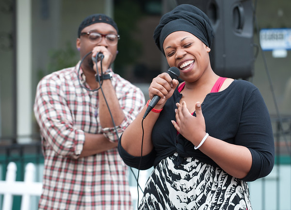 05/17/18 Wesley Bunnell | Staff The New Britain Artists' Co-op held open mic outdoors on Thursday night at KC's on Main. Oktober Brown, left, performs his remixed India Arie song &quote;The Truth&quote; along with Jenee.