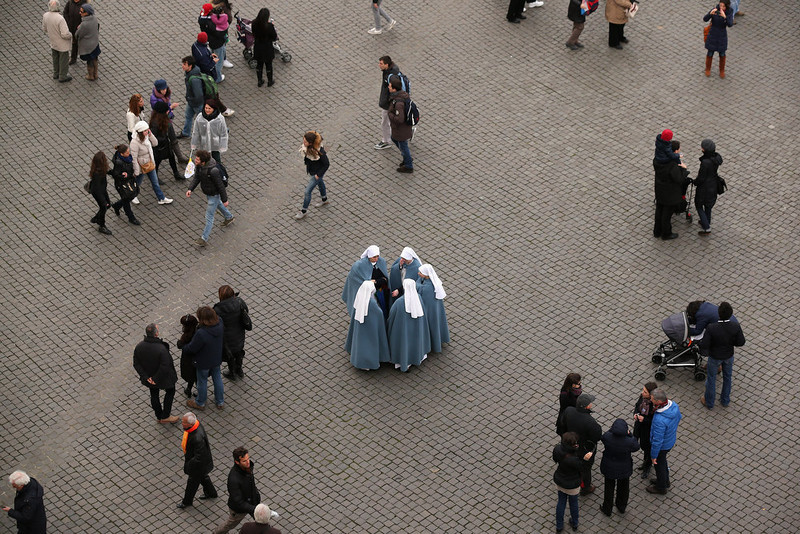 . Nuns talk in a circle as faithful walk around after Pope Benedict XVI delivered his last Angelus Blessing from the window of his private apartment to thousands of pilgrims gathered in Saint Peter\'s Square on February 24, 2013 in Vatican City, Vatican. The Pontiff will hold his last weekly public audience on February 27, 2013 before he retires the following day. Pope Benedict XVI has been the leader of the Catholic Church for eight years and is the first Pope to retire since 1415. He cites ailing health as his reason for retirement and will spend the rest of his life in solitude away from public engagements.  (Photo by Oli Scarff/Getty Images)