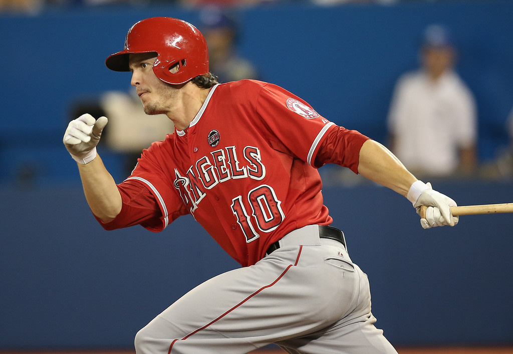 . TORONTO, CANADA - SEPTEMBER 11: Grant Green #10 of the Los Angeles Angels of Anaheim hits a double in the fifth inning during MLB game action against the Toronto Blue Jays on September 11, 2013 at Rogers Centre in Toronto, Ontario, Canada. (Photo by Tom Szczerbowski/Getty Images)