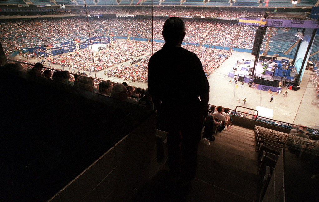 . A Promise Keeper listens to the message during their rally at the Pontiac Silverdome.