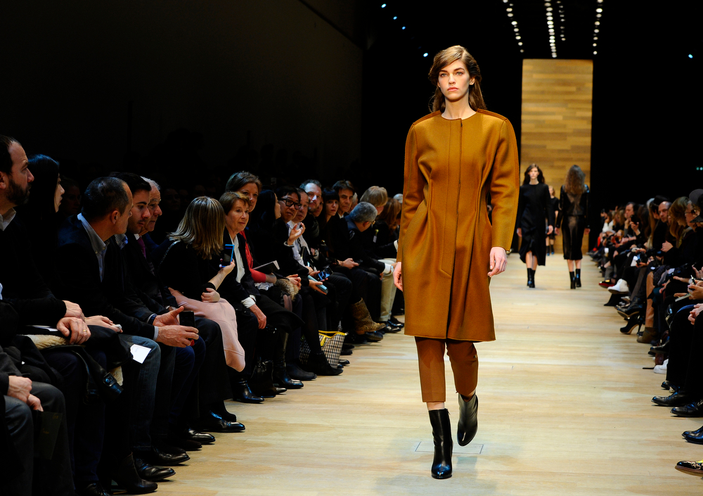 . A model wears a creations for Guy Laroche\'s ready-to-wear fall/winter 2014-2015 fashion collection presented in Paris, Wednesday, Feb.26, 2014. (AP Photo/Zacharie Scheurer)