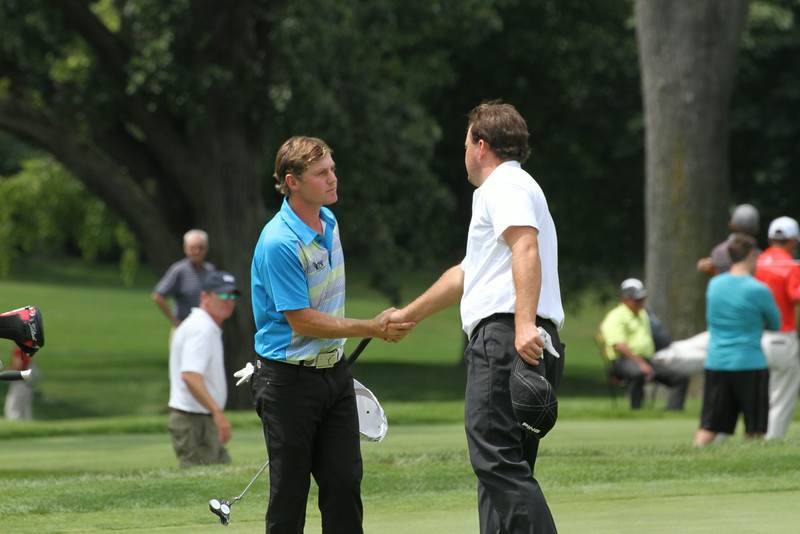 Joshua Munn and Tom Loveland of Birmingham, Alabama shake hands following the first round of the 2014 Western Amateur.