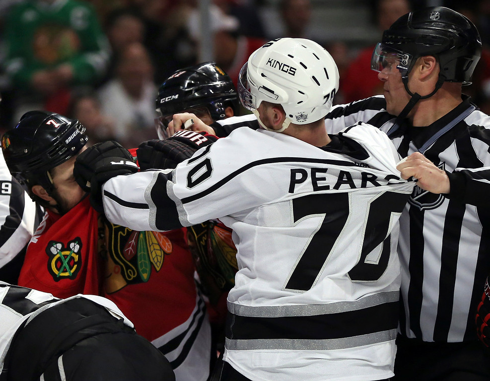 . Tanner Pearson #70 of the Los Angeles Kings fights with Brent Seabrook #7 of the Chicago Blackhawks during Game Five of the Western Conference Final in the 2014 Stanley Cup Playoffs at United Center on May 28, 2014 in Chicago, Illinois.  (Photo by Jonathan Daniel/Getty Images)