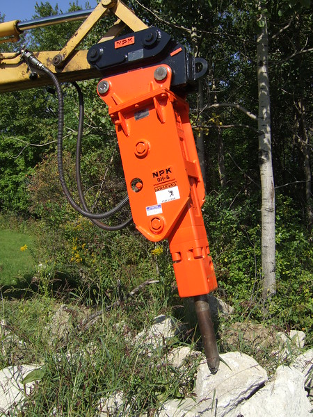 NPK GH4 hydraulic hammer with quick attachon Cat backhoe at NPKCE (27).JPG