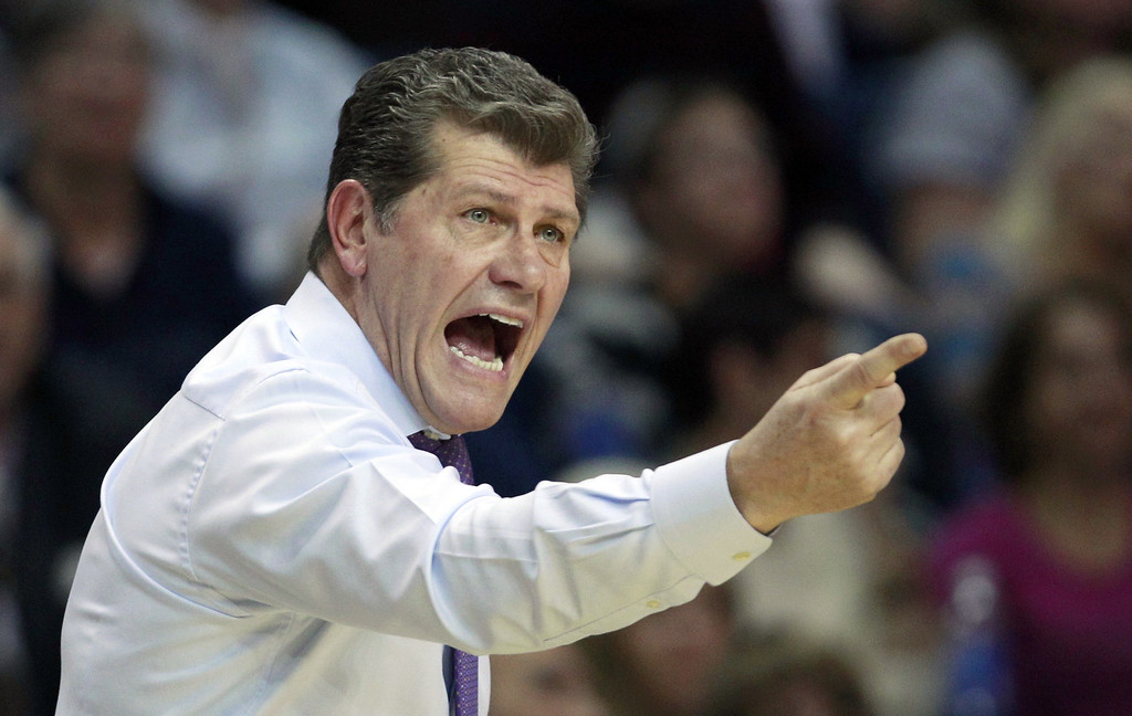 . Connecticut head coach Geno Auriemma calls to his players during the first half of a women\'s NCAA college regional semifinal basketball game against Maryland in Bridgeport, Conn., Saturday, March 30, 2013. (AP Photo/Charles Krupa)