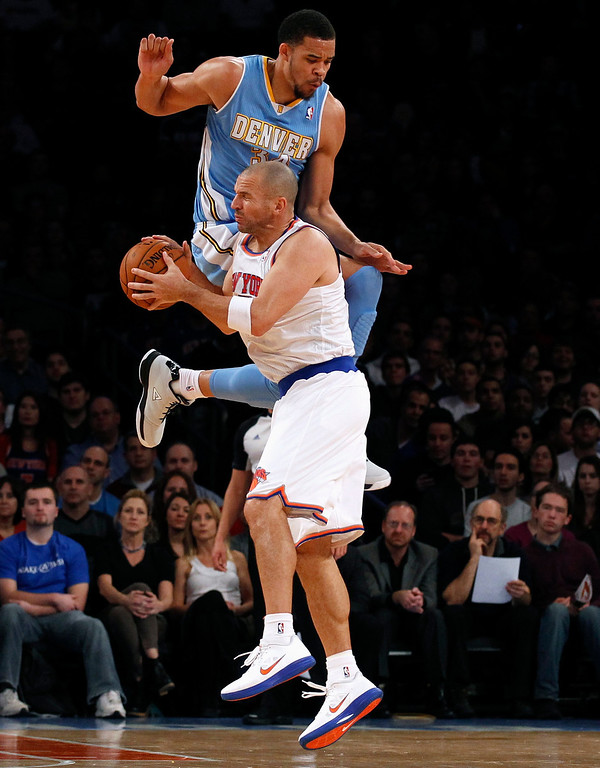 . New York Knicks point guard Jason Kidd is fouled as he attempts a shot by Denver Nuggets center JaVale McGee in the second quarter of their NBA basketball game at Madison Square Garden in New York, December 9, 2012. REUTERS/Adam Hunger
