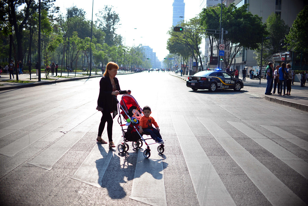 . A woman pushes a baby stroller across an avenue as people evacuate buildings after a strong earthquake rattled Mexico City on April 18 , 2014. A powerful 7.0-magnitude earthquake rattled Mexico City on Friday, swaying buildings, shattering windows and prompting people to rush into the street as power went out, authorities said. The National Seismology Service said the quake\'s epicenter was 31 kilometers (19 miles) northwest of Tecpan, in the southwestern state of Guerrero, near the Pacific resort of Acapulco. The US Geological Survey gave a higher measurement of 7.5-magnitude.           (YURI CORTEZ/AFP/Getty Images)
