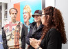 SPG photographer Ellen Jacob (right) speaking with visitors to her show