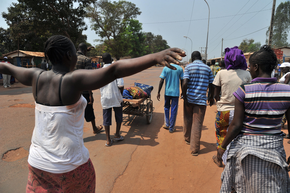 . People push a cart in Bangui on January 29, 2014 carrying the body of a Christian man killed by Anti-Balaka combatants after he was mistaken for a Muslim. Gunfire erupted on January 29 in Bangui, still plagued by looting despite the security operations of French and African soldiers, now awaiting the reinforcement of a European force whose engagement has been authorized by the United Nations. (ISSOUF SANOGO/AFP/Getty Images)