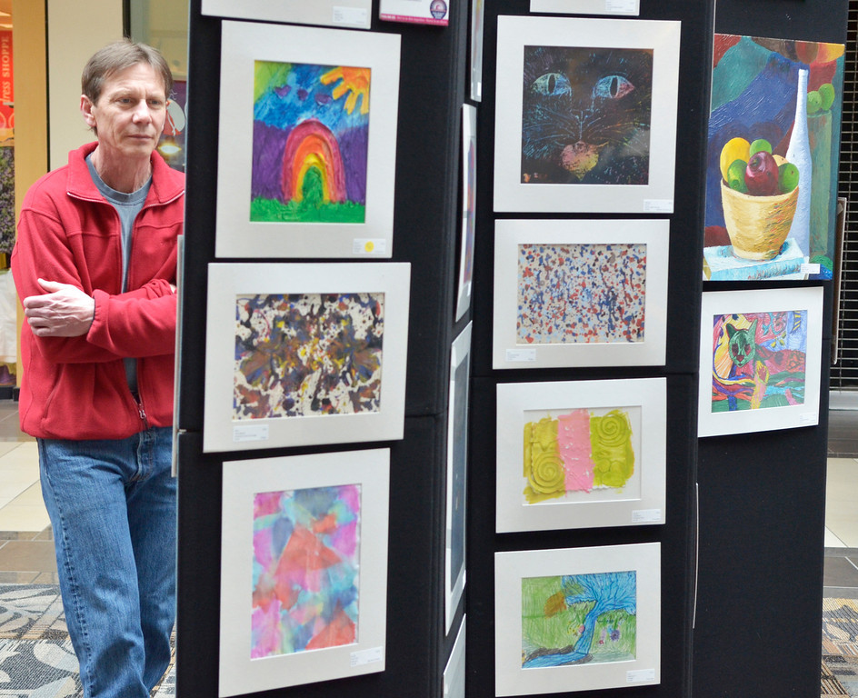 """. Jeff Forman/JForman@News-Herald.com Ken Irons looks at work on display in the \""""Expressions of Recovery\"""" exhibit at the Great Lakes Mall. The show is sponsored by the Lake County ADAMHS Board."""