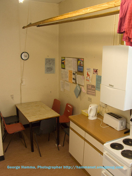 There's a small table for dining.  There's a clothes-drying rack that can be lowered using a rope-and-pully system.  The ground-floor kitchen has a washer/dryer that's free, shared by all the floors at that address.