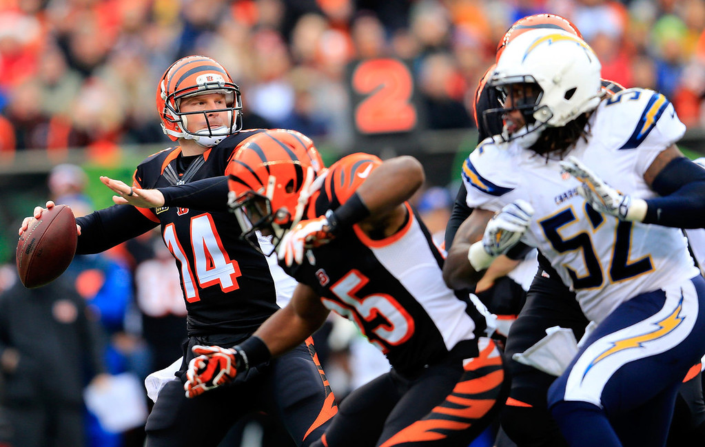 . Quarterback Andy Dalton #14 of the Cincinnati Bengals throws a first half pass against the San Diego Chargers during the AFC Wild Card playoff game at Paul Brown Stadium on January 5, 2014 in Cincinnati, Ohio.  (Photo by Rob Carr/Getty Images)