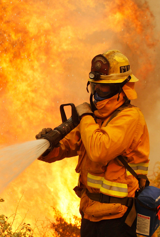 . A firefighter battles the Springs Fire at Point Mugu State Park May 3, 2013.  REUTERS/Jonathan Alcorn