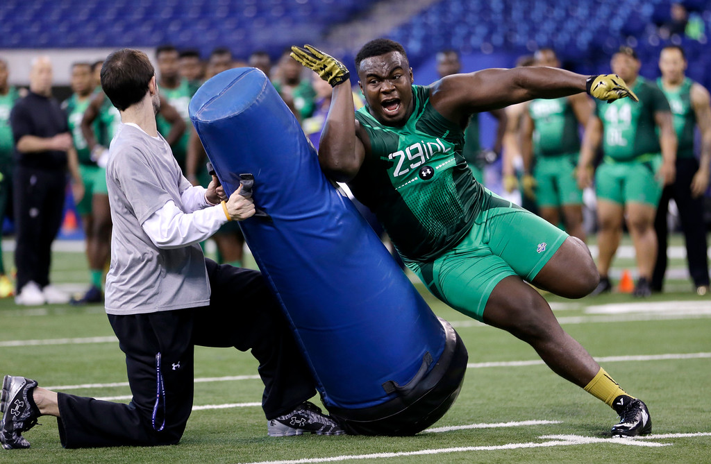 . Clemson defensive lineman Grady Jarrett runs a drill at the NFL football scouting combine in Indianapolis, Sunday, Feb. 22, 2015. (AP Photo/Julio Cortez)