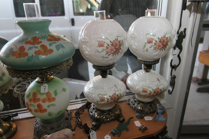 Lamps in the window of Antiques & Collectibles.