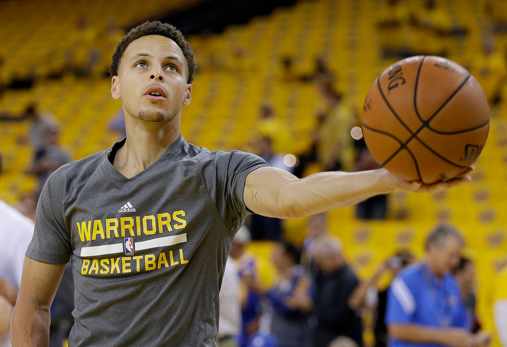 . Golden State Warriors guard Stephen Curry warms up before Game 1 of basketball\'s NBA Finals against the Cleveland Cavaliers in Oakland, Calif., Thursday, June 4, 2015. (AP Photo/Ben Margot)