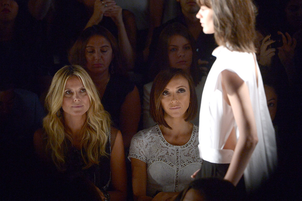 . Model Heidi Klum (L) and television personality Giuliana Rancic attend the BCBGMAXAZRIA Spring 2014 fashion show during Mercedes-Benz Fashion Week at The Theatre at Lincoln Center on September 5, 2013 in New York City.  (Photo by Michael Loccisano/Getty Images for Mercedes-Benz Fashion Week)