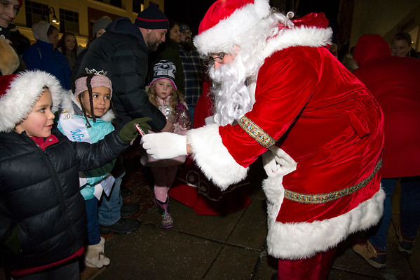 12/03/19 Wesley Bunnell | StaffrrThe 68th annual Bristol Carol Sing and 29th annual Tree Lighting presented by Webster Bank and the Central CT Chambers of Commerce took place on Tuesday night outside to Webster Bank at 150 Main St. Santa Claus hands Matthew Hull, age 6 , a candy cane.