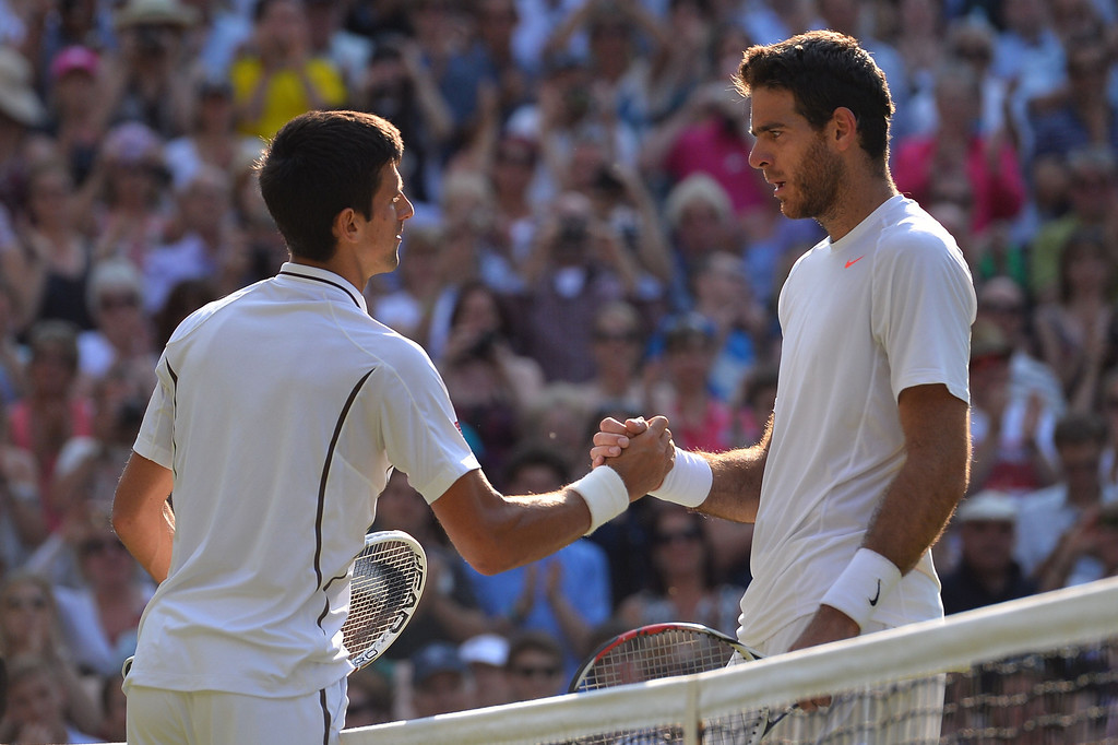 . Serbia\'s Novak Djokovic (L) talks and shakes hands with Argentina\'s Juan Martin Del Potro (R) following Djokovic\'s victory in their men\'s singles semi-final match on day eleven of the 2013 Wimbledon Championships tennis tournament at the All England Club in Wimbledon, southwest London, on July 5, 2013. Djokovic won 7-5, 4-6, 7-6, 6-7, 6-3. CARL COURT/AFP/Getty Images