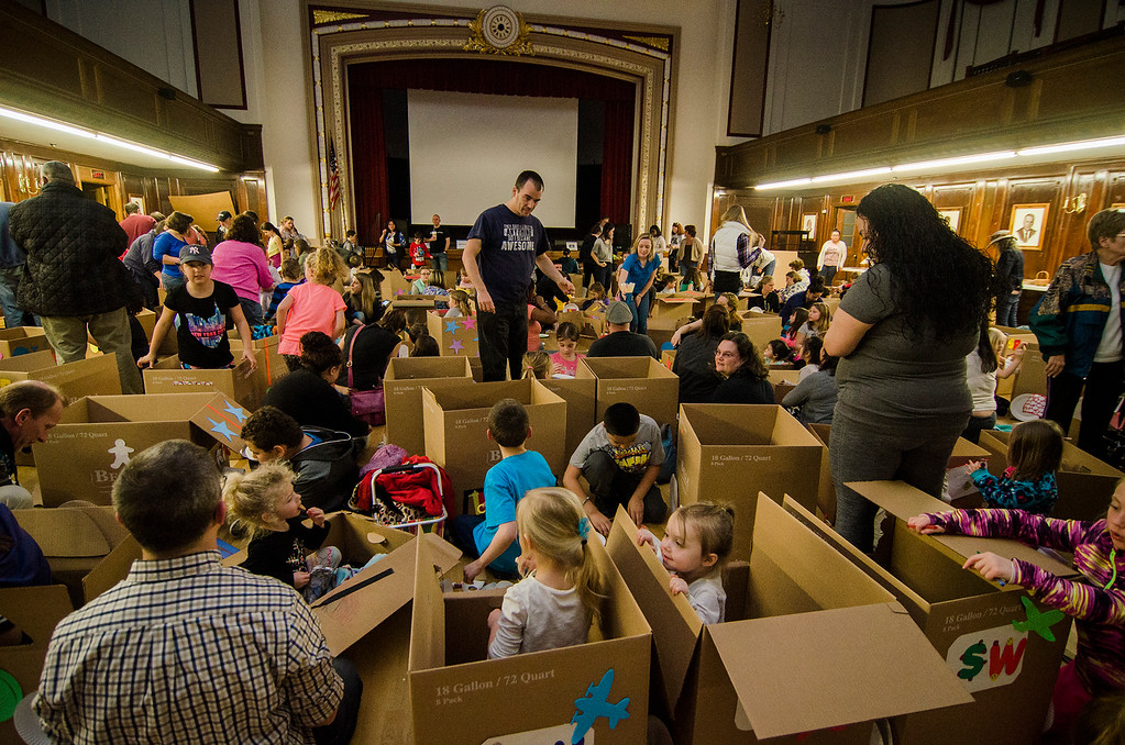 . Children pile in their cardboard cars during the drive-in movie at Leominster City Hall on Thursday, February 23, 2017. Children were able to come in and design their own box car and enjoy pizza and snacks while watching \'Zootopia\' on a large projector screen. SENTINEL & ENTERPRISE / Ashley Green