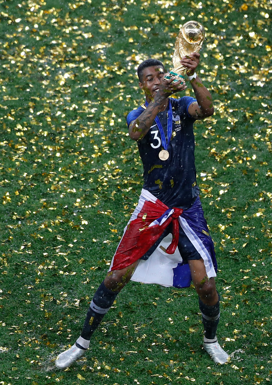 . France\'s Presnel Kimpembe holds the trophy after the final match between France and Croatia at the 2018 soccer World Cup in the Luzhniki Stadium in Moscow, Russia, Sunday, July 15, 2018. (AP Photo/Frank Augstein)