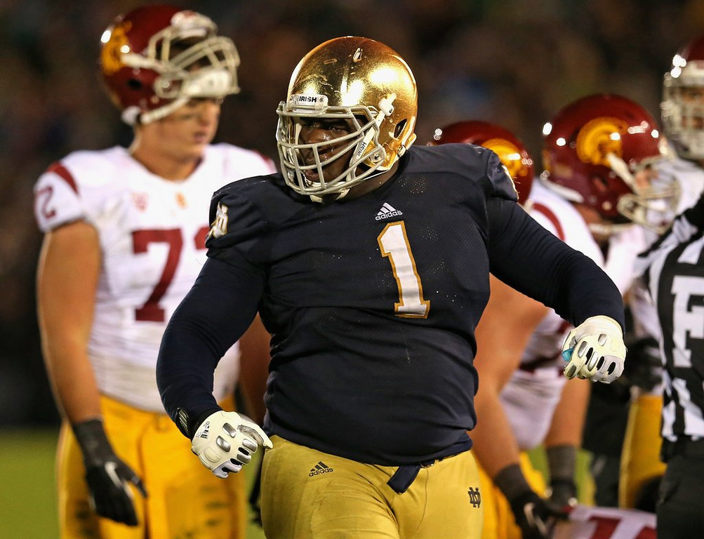 """. <p><b>32. Seattle: Louis Nix III, DT, Notre Dame. </b> <p>It might be somewhat painful for former USC coach Pete Carroll to take a Fighting Irish star, but the Seahawks could use help on the defensive line.  <p>Follow Chris Tomasson at <a href=\""""http://twitter.com/christomasson\"""">twitter.com/christomasson</a>.   (Jonathan Daniel/Getty Images)"""