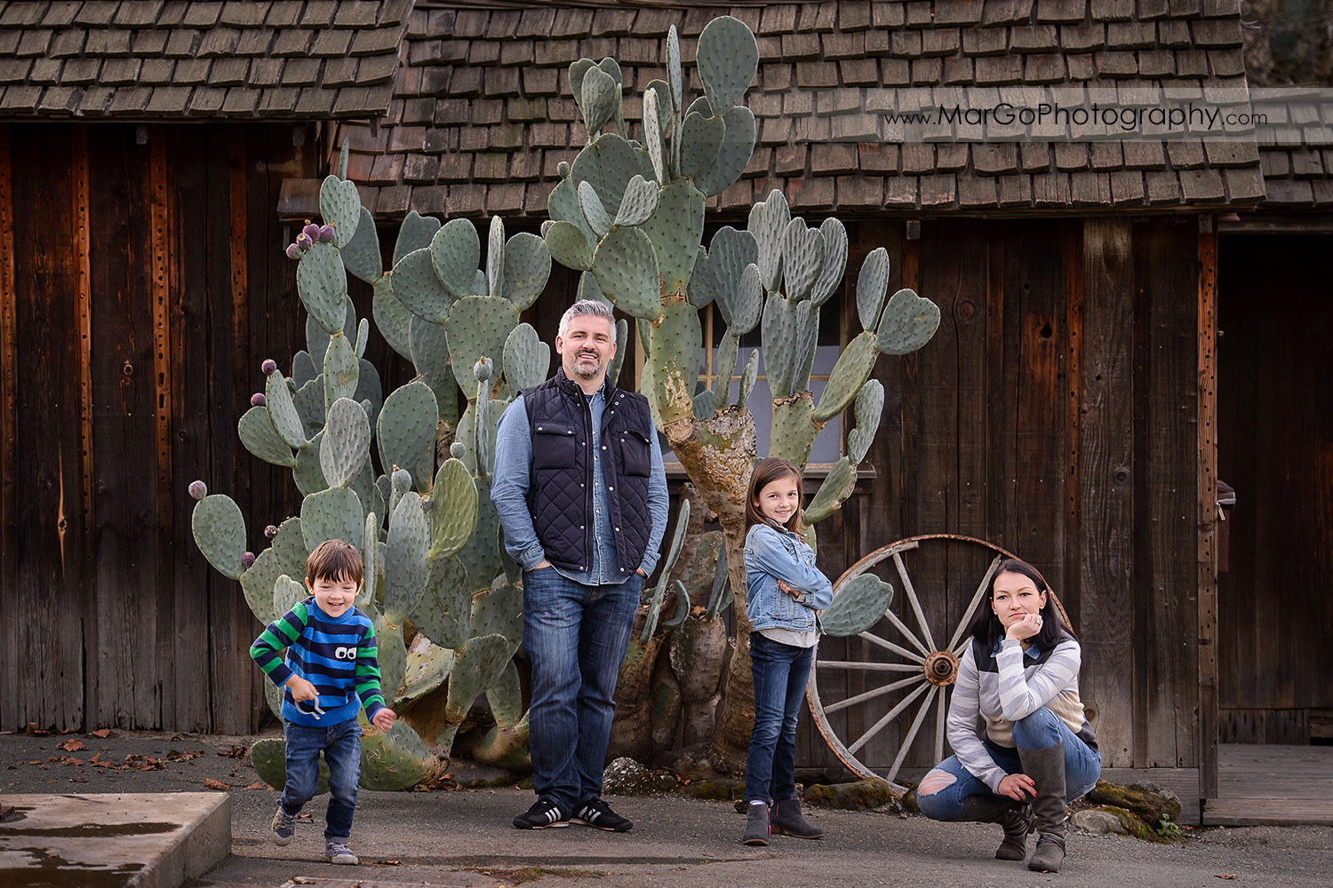 full body horizontal portrait of family of 4 in blue and grey clothes during photo session at Old Borges Ranch in Walnut Creek