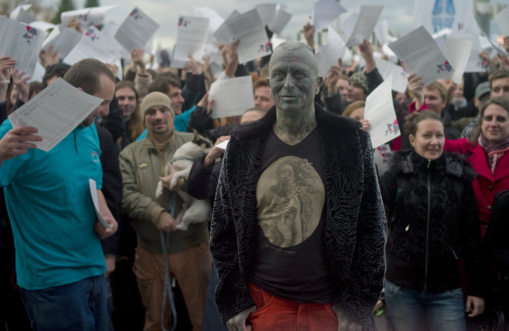 ". Picture taken on November 5, 2012 shows Czech fully-tattooed artist and drama professor Vladimir Franz react as he stands in front of supporters, cheering as he announces the collection of 88,388 signatures to become eligible for the Czech presidential elections 2013, in Prague, Czech Republic. Despite having no political track record, Franz is running third among nine contenders, according to some opinion polls. ""The world of art gives you the capacity to speak authentically about things, you\'re not infected with the newspeak that people are so fed up with these days,\"" Franz told AFP. MICHAL CIZEK/AFP/Getty Images"