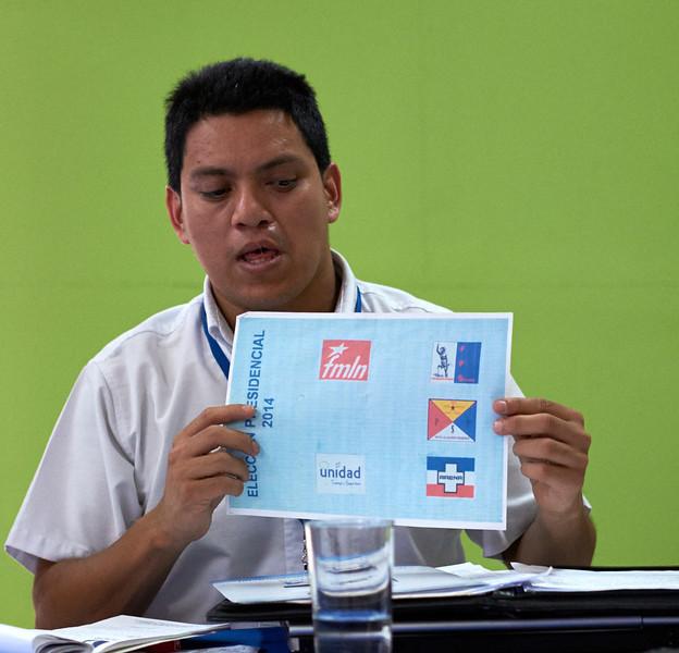 Nelson Carcamo of the TSE (supreme electoral tribunal) displays a sample ballot to the delegates.