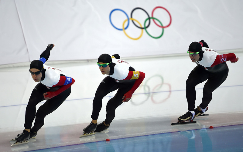 . (L-R) Canada\'s Denny Morrison, Lucas Makowsky and Mathieu Giroux compete in the Men\'s Speed Skating Team Pursuit Semifinals at the Adler Arena during the Sochi Winter Olympics on February 21, 2014.  (DAMIEN MEYER/AFP/Getty Images)