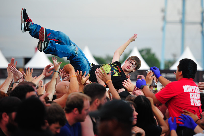 A fan crowd surfs during the Meshuggah perform at the 1st Annual Chicago Open Air Festival. Friday, July 15th, 2016, at Toyota Park in Bridgeview. | Gary Middendorf-Chicago Tribune Media Group