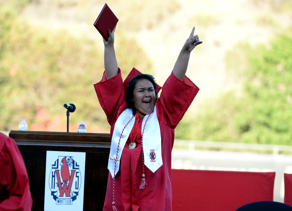 . Graduate Nicole Garcia reacts after receiving her diploma during the Whittier High School graduation at Whittier College in Whittier, Calif., on Wednesday, June 4, 2014.  (Keith Birmingham/Pasadena Star-News)