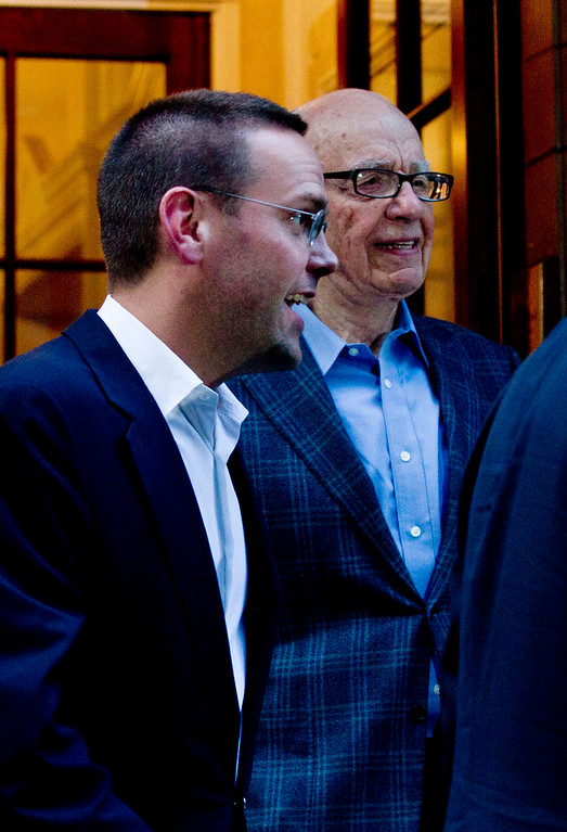 . Chairman of News Corporation Rupert Murdoch, right, and his son James Murdoch, chief executive of News Corporation Europe and Asia leaves a hotel to his residence across the road in central London, Sunday, July 10, 2011. (AP Photo/Sang Tan)