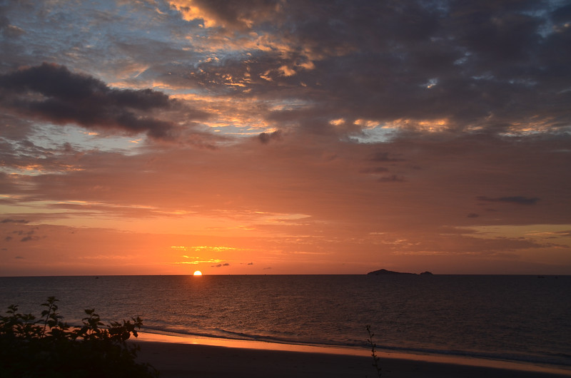 Orange cloudy tropical sunrise seascape, Thailand.