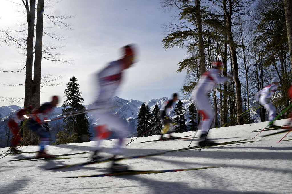 . Athletes compete during the Men\'s Cross-Country Skiing 50km Mass Start Free at the Laura Cross-Country Ski and Biathlon Center during the Sochi Winter Olympics on February 23, 2014, in Rosa Khutor, near Sochi. ODD ANDERSEN/AFP/Getty Images