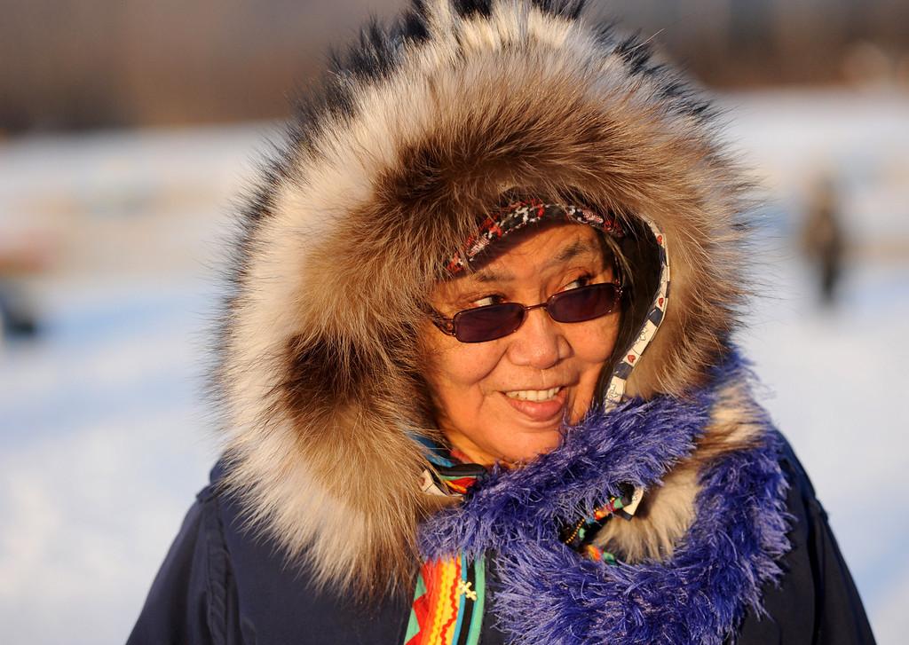 . Nikolai resident Oline Petruska, talks with visitors at the Nikolai, Alaska, checkpoint during the Iditarod Trail Sled Dog Race at sunrise Wednesday, March 5, 2014. (AP Photo/Anchorage Daily News, Bob Hallinen)