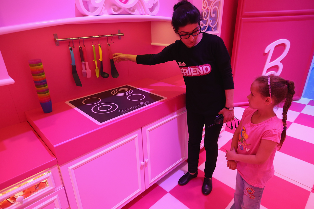 . Lina, 7, gets a tour of the kitchen at the Barbie Dreamhouse Experience on May 16, 2013 in Berlin, Germany. The Barbie Dreamhouse is a life-sized house full of Barbie fashion, furniture and accessories and will be open to the public until August 25 before it moves on to other cities in Europe.  (Photo by Sean Gallup/Getty Images)
