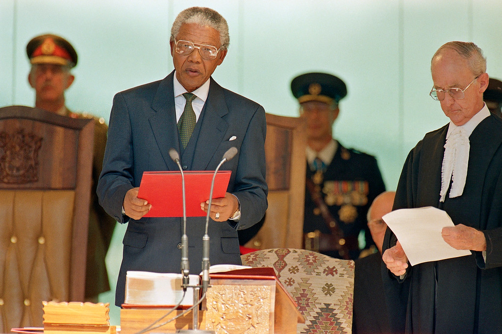 . Nelson Mandela reads the oath of office Tuesday, May, 10, 1994 at the Union Building in Pretoria as he is sworn in as President of South Africa. Mandela is the first black President in the history of the republic. (AP Photo/John Parkin)
