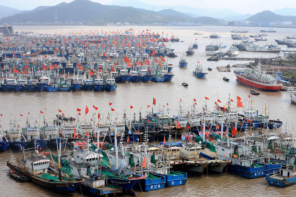 . Fishing boats berth in Zhoushan port to avoid the powerful typhoon Fitow in Zhoushan, in east China\'s Zhejiang province on October 5, 2013. China\'s National Meteorological Centre raised a red alert -- the highest level in a four-tier system -- saying the storm would make landfall in the provinces of Zhejiang and Fujian, state news agency Xinhua reported.  STR/AFP/Getty Images