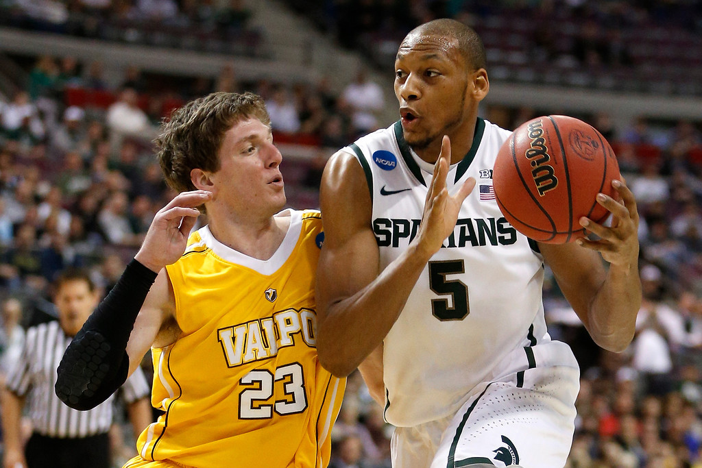 . Adreian Payne #5 of the Michigan State Spartans drives in the first half against Matt Kenney #23 of the Valparaiso Crusaders during the second round of the 2013 NCAA Men\'s Basketball Tournament at at The Palace of Auburn Hills on March 21, 2013 in Auburn Hills, Michigan.  (Photo by Gregory Shamus/Getty Images)