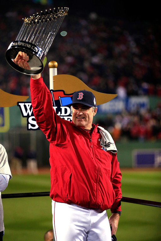 . Manager John Farrell #53 of the Boston Red Sox holds up the World Series trophy after defeating the St. Louis Cardinals 6-1 in Game Six of the 2013 World Series at Fenway Park on October 30, 2013 in Boston, Massachusetts.  (Photo by Jamie Squire/Getty Images)